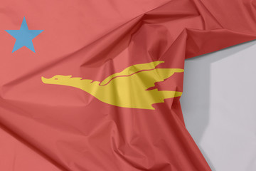 New Mon State Party fabric flag crepe and crease with white space, the golden drake flying on red to star.