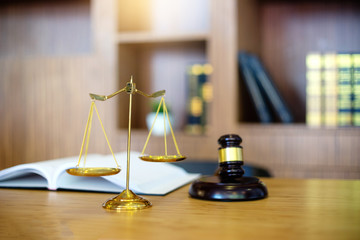 gavel and balance on the table with book