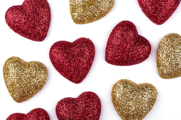 Gold and red hearts isolated