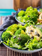Green plant based salad with broccoli and avocado
