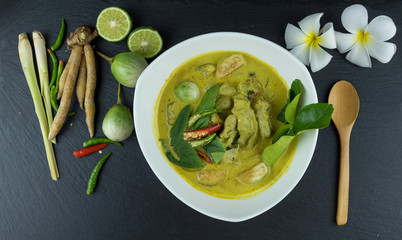 fish ball Green curry with coconut curry  (Kaeng kheiyw hwan) on dark wooden background with Thai tradition food served with steamed rice. Thai food very popular