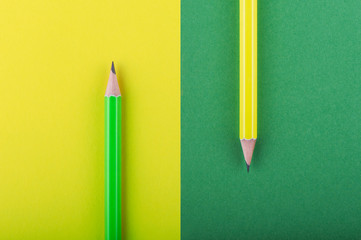 Yellow and green pencils