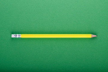 Yellow pencil on green