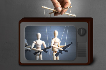 Fake News on TV. Concept of war. People with weapons, armed protest, terrorists. The puppeteer controls the doll with gun, the provoker leads crowd of people with weapons
