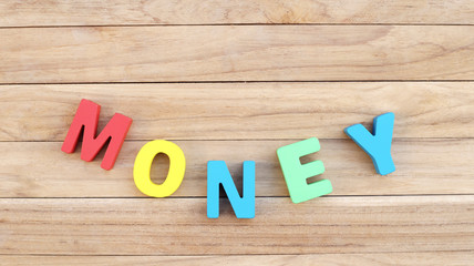 Curve of Colorful Word ' MONEY ' on Wooden Table