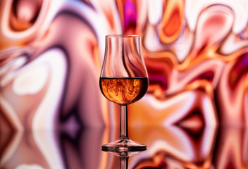 A glass of whiskey on an abstract background