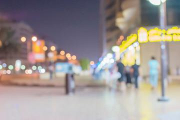 Blurred image of nightlife in the city. Defocused photo of night lights