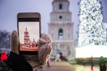 A girl takes pictures on the phone the Church