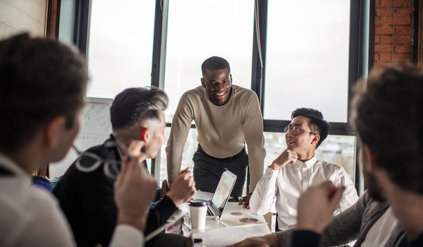 African american business couch provides to a multiracial group of employees corporate training, Stress and work-life issues were integrated into the corporate learning plan.