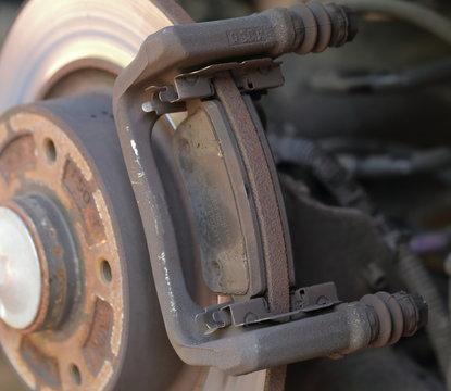 Worn disc brake pads to be changed