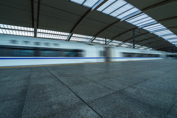 speeding train away from railway station, shanghai china.