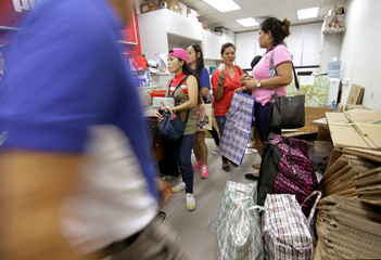 Filipina domestic workers send donated and dumpster dived items to the Philippines, in Singapore