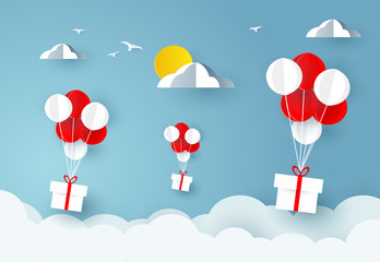 Balloons carries gift boxes over sky. Paper art