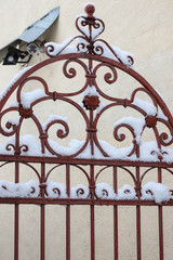Fragment of the upper part of the forged gate with openwork elem