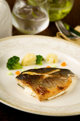 sea bass fillet with curd sauce and broccoli