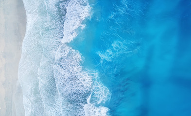 Beach and waves from top view. Turquoise water background from top view. Summer seascape from air. Top view from drone. Travel concept and idea Wall mural