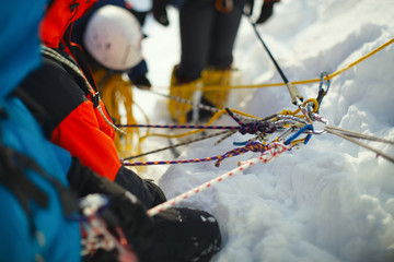 Foto op Aluminium Alpinisme A group of climbers on a snow-covered mountain slope secured on a safety rope. Climbing station. Tilt-shift effect.