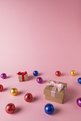 Creative layout of colored candy and gift box on pink background