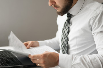 Businessman working with documents White background. Shopping online. Office work concept. Businessman uses a smartphone. sending email, mobile phone. Close up telephone.