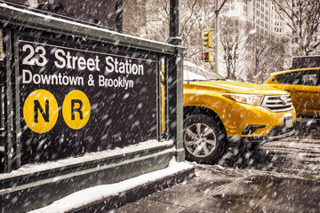Door stickers New York TAXI Midtown New York City Manhattan street scene at the 23rd subway street station with yellow taxi cab and snowflakes falling during winter snow storm