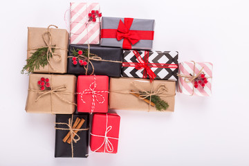 Modern gifts on a white table with copy space. Christmas background. View from above. Flat lay
