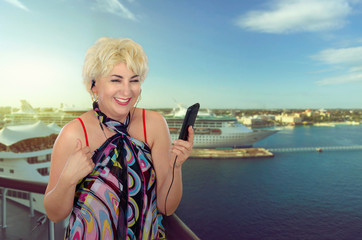Happy blond woman on cruise ship