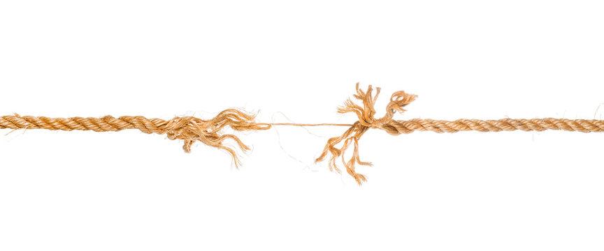Long frayed rope near to break isolated