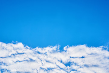 Deep blue sky with clouds below. Abstract background.