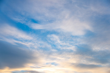 Blue sky with white clouds at sunset
