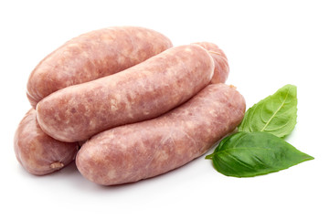 German Oktoberfest Sausages with basil leaf, close-up, isolated on white background
