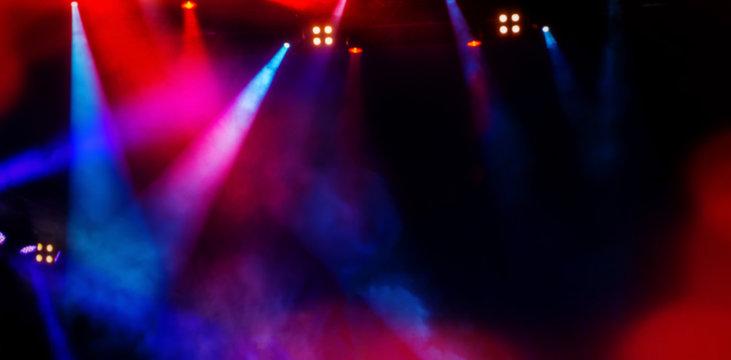 floodlights scene during a rock concert. Blurred background.