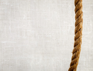 Rope on rough white burlap texture background with copy space