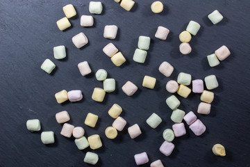 a lot of marshmallows on a black background