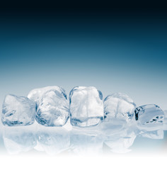 Ice cubes on blue background. Clipping path included.