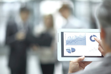 close up.blurred image of businessman using a digital tablet. photo with copy space