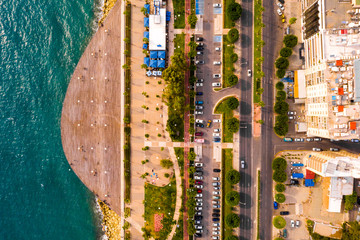 Fototapete - Aerial view of Molos Promenade park on coast of Limassol city centre in Cyprus. Bird's eye view of the jetty, beachfront walk path and palm trees by the sea.