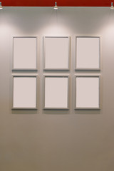 Six blank wooden picture frames on beige color wall decoration contemporary