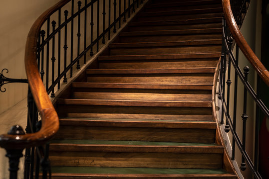 Elegant wooden staircase with railing.