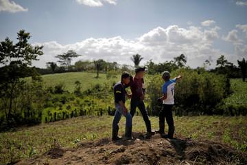 Local children look over a farm land near San Antonio Secortez