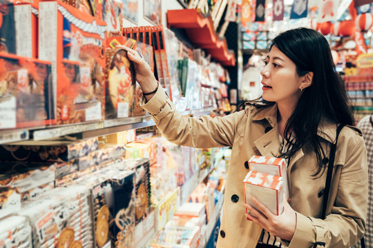 asian girl traveler visiting local specialty shop