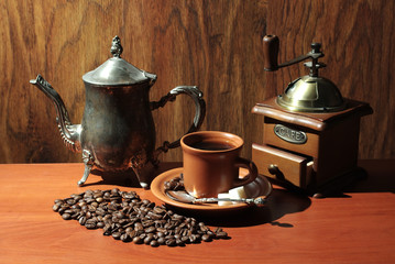 Coffee cup, coffee pot and coffee grinder