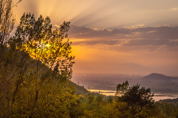 Sun setting over Dal Lake in Kashmir as seen from Sunset Point near Nishat