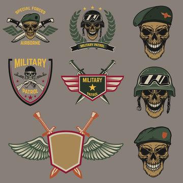 Set of military emblems. Paratrooper skull with crossed knives.Design element for logo, label, emblem, sign.