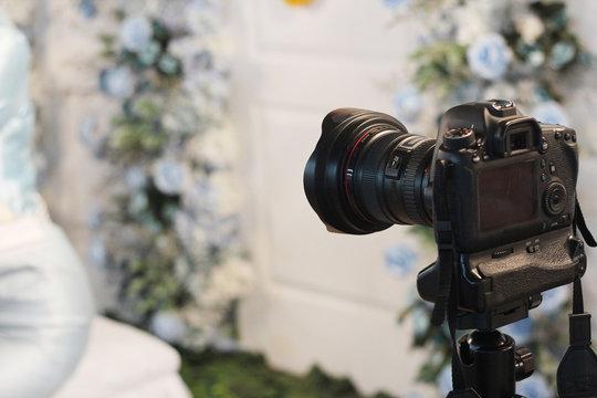 camera standing work in wedding