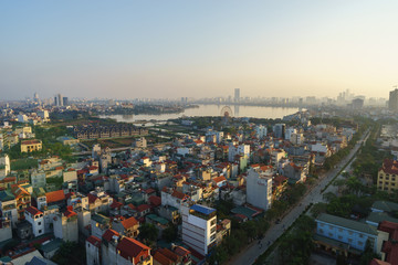 Aerial skyline view of Hanoi city, Vietnam. Hanoi cityscape by sunset period at West Lake, Ho Tay district