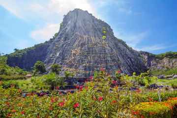 Pattaya, Thailand, Golden Buddha Mountain. On a huge rock burned by laser and lined with gold plates image of the Buddha, which is the largest in the world. Buddha's height is 130 m and width is 70 m