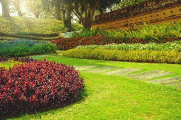 Patterns of concrete walkway step on the green grass in the park, Pathway in garden, Green lawns with bricks pathways, Garden landscape design.