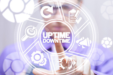 Uptime downtime web business technology concept. Businessman clicks a uptime downtime words button on a virtual modern digital screen.