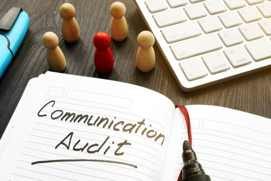 Communication audit written in a note and wooden figures.