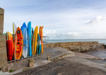 Colourful Sea Canoes in Rack, St Ives, Cornwall, UK